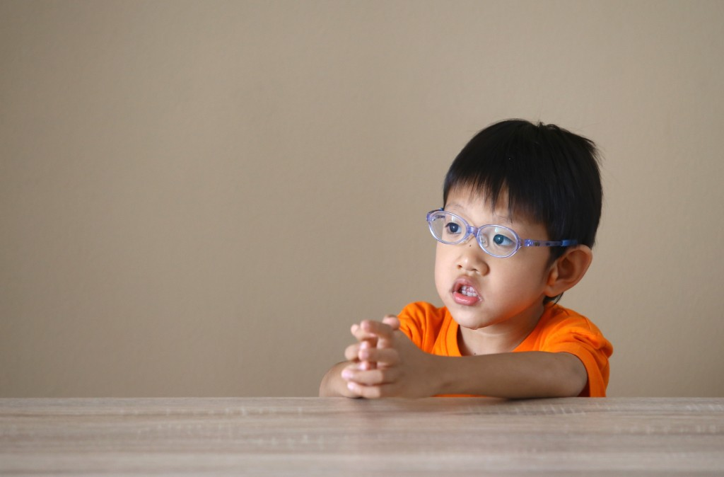 """Lee Yihong is 5 but has the mental age of a 14-month-old. He wears 800-degree glasses and only knows one word: """"There"""". We speak to his parents to find out how they cope. NP 01032015 1505984831 Benjamin Seetor"""